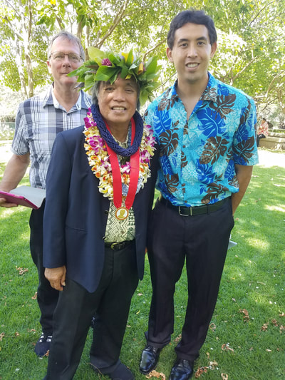 Rob Kajiwara (right) with H.E. Leon Siu, Minister of Foreign Affairs of the Hawaiian Kingdom (left) at an award ceremony. Dr. Leon Watson of Hawaii Tokai International College is in the back.